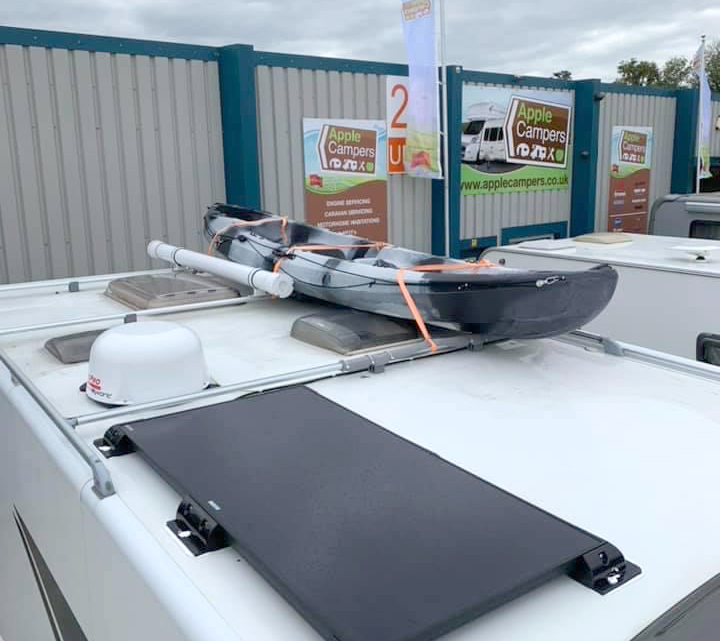 kayak attached to motorhome with roof rack